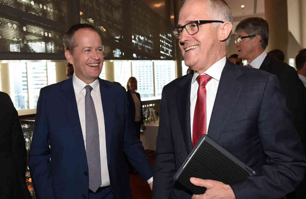 Prime minister Malcolm Turnbull and opposition leader Bill Shorten arrive at the grand final breakfast ahead of the GF today in Melbourne, Saturday Oct. 3, 2015. (AAP Image/Tracey Nearmy) NO ARCHIVING EDITORIAL USE ONLY